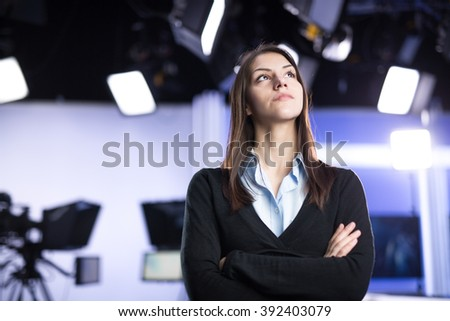 Woman journalist working as reporter,correspondent or broadcast news analysts in TV studio.Public information about news events happening internationally.Conducting interviews and investigating story - stock photo