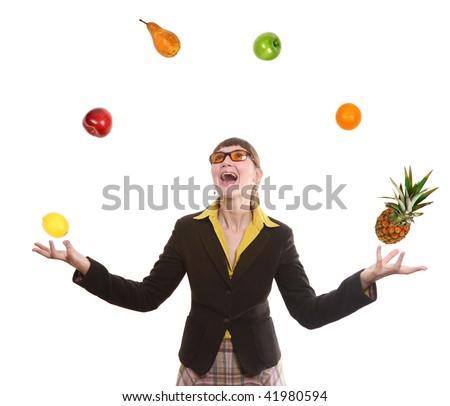 woman juggling fruit - stock photo