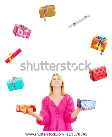 Woman juggling with some colorful gifts - stock photo