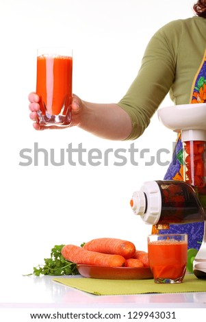 Woman Juice extractor and carrot isolated white kitchen prepare - stock photo