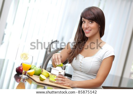 Woman juicing lime - stock photo