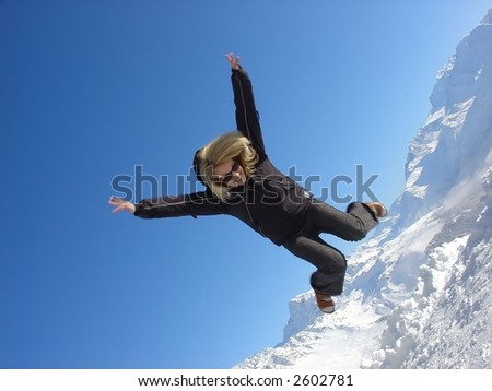 woman jump mountain top - stock photo