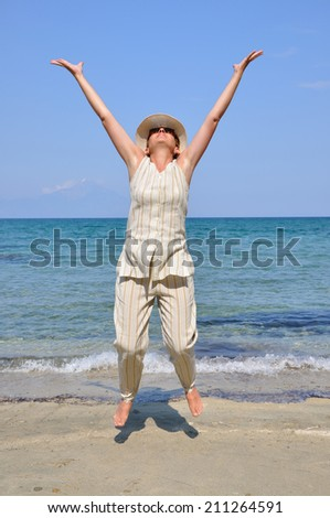 Woman  jumping and having fun on the beach