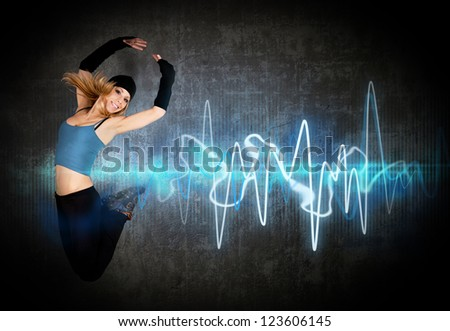 Woman jumping/dancing to the music rhythm