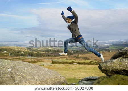 Woman Jumping From Rock To Rock - stock photo