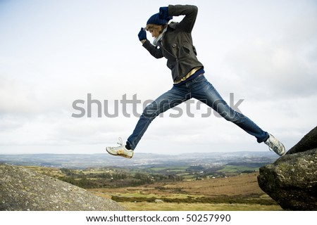 Woman Jumping In Mid Air - stock photo