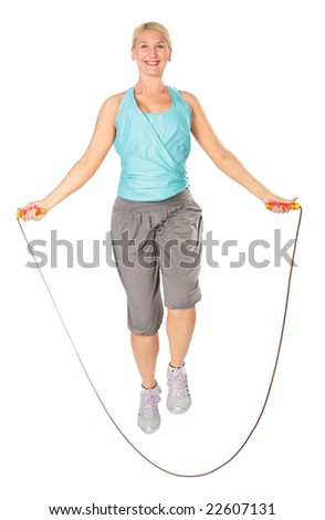 Woman jumps with a skipping rope - stock photo