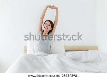 Woman just wake up with hand stretching - stock photo