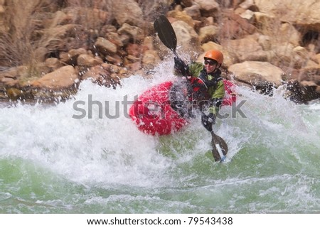 Woman Kayaking the River
