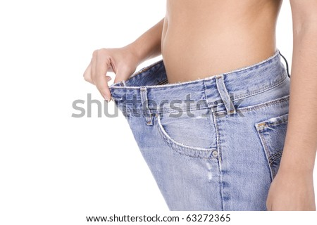 woman keeping a diet measuring her belly