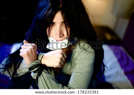 Woman kidnapped at home by violent men - stock photo