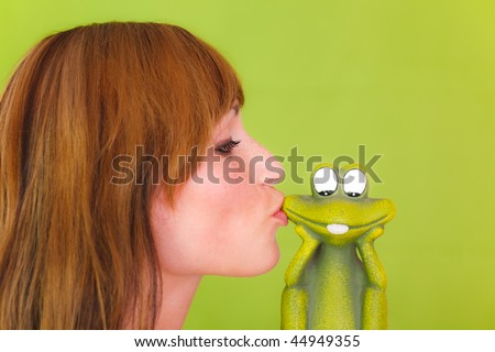 Woman kissing frog as concept of a single girl relationship searching girl - stock photo