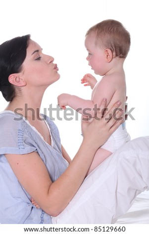 woman kissing her baby