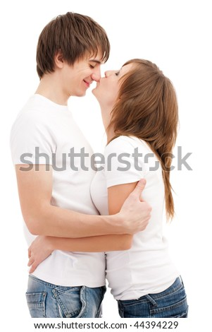 Woman kissing man. Young attractive couple  Young attractive couple - stock photo