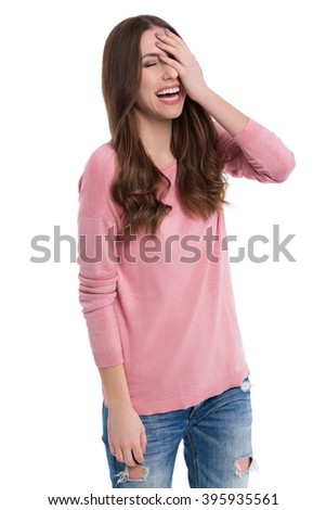 Woman laughing, head in hand  - stock photo