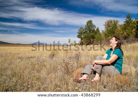 Woman Laughing in Field - stock photo