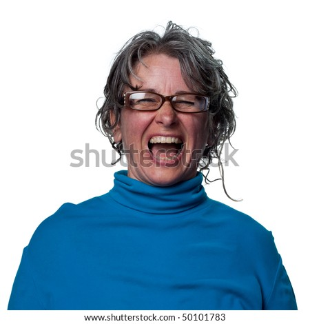 Woman laughing out loud in reaction to a funny joke - stock photo