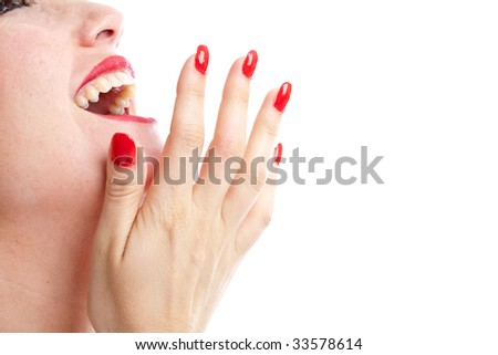 Woman laughing out loud with her hand in front of her mouth - stock photo