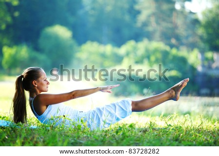 woman lay and training on ground - stock photo