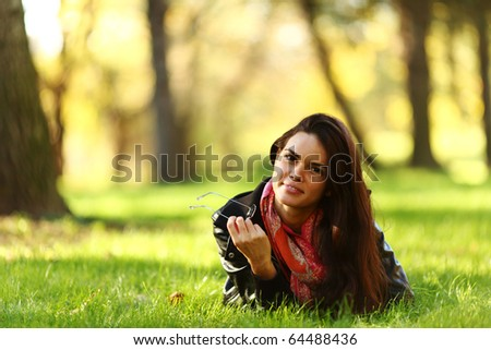 woman lay on green grass - stock photo