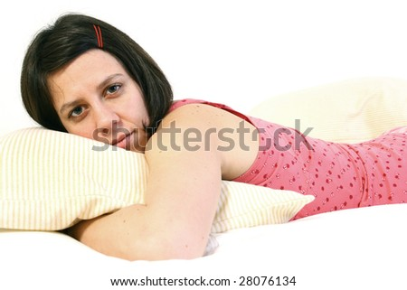 Woman laying in bed - stock photo