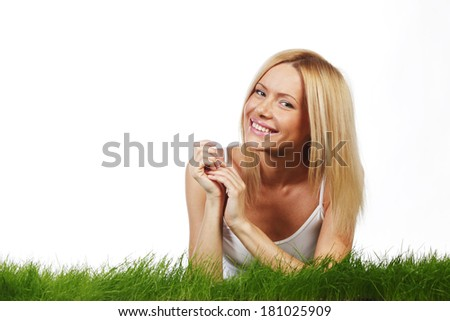 Woman laying on grass, isolated on white background