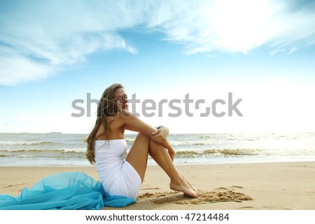 woman laying on sand - stock photo