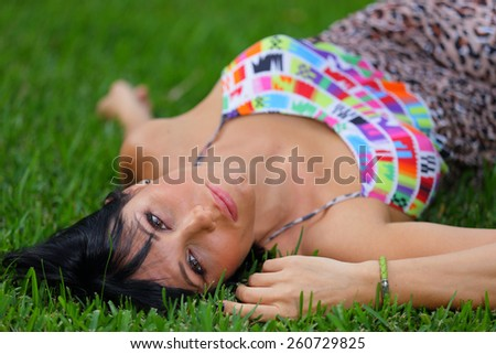 Woman laying on the grass - stock photo