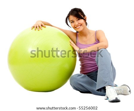 Woman leaning on a pilates ball isolated over a white background