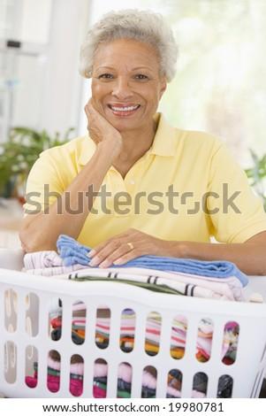 Woman Leaning On Washing Basket - stock photo