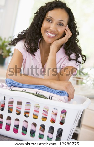 Woman Leaning On Washing In Basket - stock photo