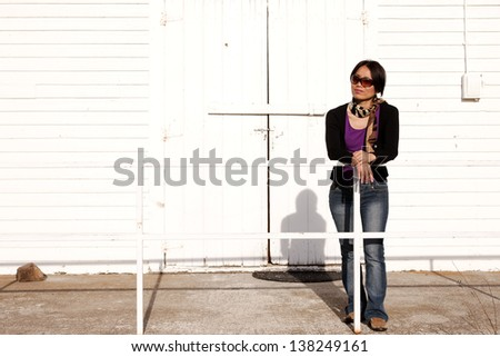 Woman leans over on railing. - stock photo