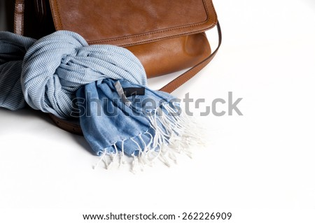 Woman leather bag with scarf closeup isolated on white. Light brown color - stock photo