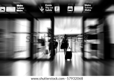 Woman leaving the airport - stock photo
