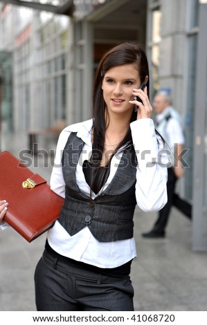 Woman. Leaving the work. In a shopping center. telephone conversation