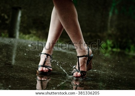 woman leg and water splashes