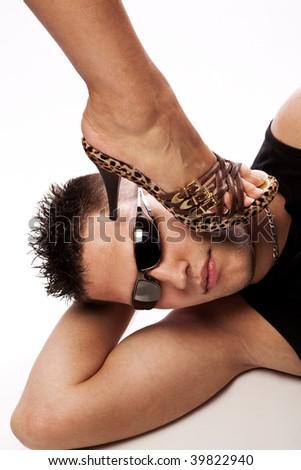 woman leg in high heel on man head, studio white - stock photo