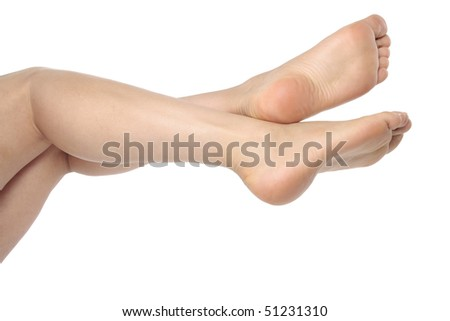 Woman legs and feet isolated over white background - stock photo