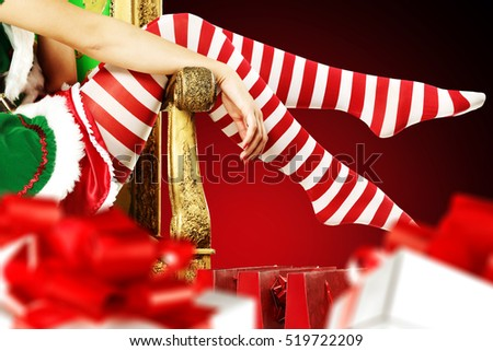 woman legs and golden chair with few boxes of gifts