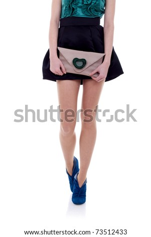woman legs and little purse over white background - stock photo