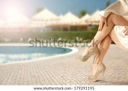 woman legs and pool  - stock photo