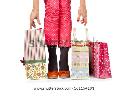 Woman legs and shopping bags