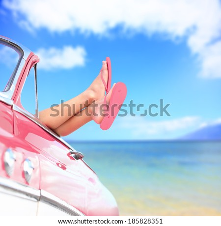 Woman legs by blue sea background in car. Summer vacations concept with free woman enjoying freedom.