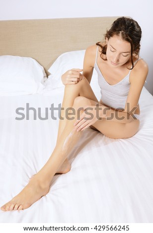 woman legs care  in the bed