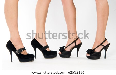 woman legs in black shoes. Isolated on white background - stock photo