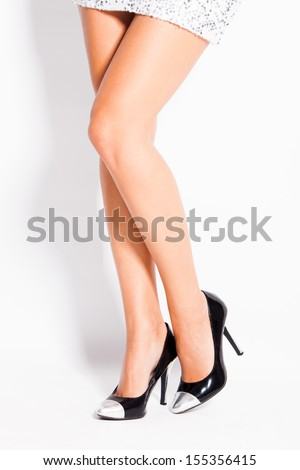 woman legs in elegant black and silver high heel shoes studio shot - stock photo