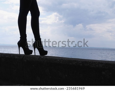 woman legs in high heel shoes outdoor shot