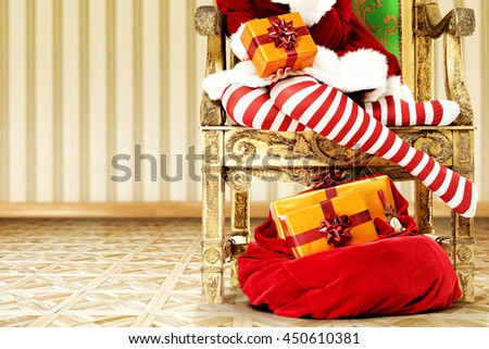 woman legs in red and white stocking and gifts