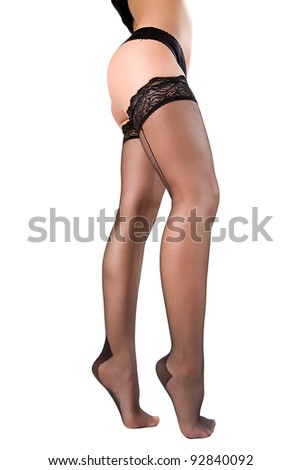 woman legs in stockings. Isolated on white. - stock photo