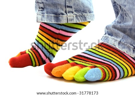 woman legs in strip sock on white background - stock photo